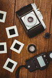 View of an old camera with photos slides Royalty Free Stock Photos