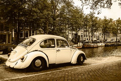 View at an old canal in Amsterdam with classic car Royalty Free Stock Image