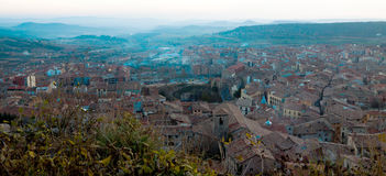 View of old Catalan town in sunset. Berga. Top view of Berga in winter twilight. Catalonia, Spain royalty free stock images