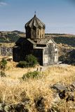 View of an old church next to the medieval fortress of Amberd in Royalty Free Stock Images
