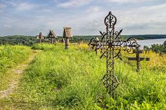 View of the old churchyard cemetery. Cemetery with rickety crosses. Kizhi Island, Onega Lake, Karelia. Russia royalty free stock image