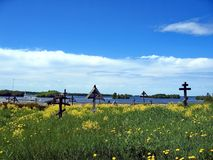 View of the old churchyard cemetery. Cemetery with rickety crosses. Russian North. Kizhi Island, Onega Lake, Karelia. Russia stock photos