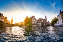 The city center of bruges seen from the water. A view of the old city center of bruges from the boat on water royalty free stock photography