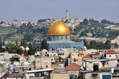 The temple mount with the golden dome in the old city of Jerusalem. View of the old city of Jerusalem Israel seen from the roofs is the temple mount as the Stock Photos