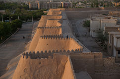 View of old city khiva walls. In evening Stock Photos