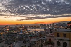 View of old city and the port at sunset, Genoa, Italy. stock photos