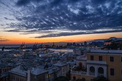 View of old city and the port at sunset, Genoa, Italy. stock images