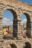 Segovia inside the aqueduct of Segovia with a natural frame royalty free stock photography