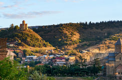 View of old city and Tabor Monastery at sunset. Tbilisi, Georgia. View of Old city and Tabor Monastery on top of mountain at sunset. Tbilisi, Georgia stock photo