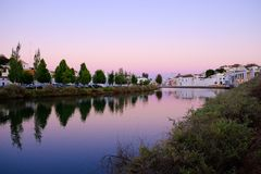 View on the old city of Tavira ond the river Gilao. View on the old city of Tavira with beautiful white houses and the river Gilao on the sunset, algarve royalty free stock images