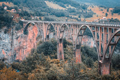 View of the old concrete arch Bridge Djurdjevica Tara in Montenegro. Stock Photography