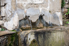 View of old drinking fountain, Jeravna, Bulgaria, Europe. Close-up view of old drinking fountain, Jeravna, Bulgaria, Europe Stock Image
