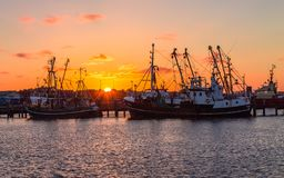 Beautiful, panoramic view on old fishing trawler on the Harbour of Romo Rømø Havn during sunset. In the Background old ships, stock photo