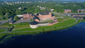 The view of the old fortress-prison on the shores of lake Vanajavesi. Hämeenlinna aerial video stock video footage