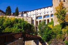 View on old gallery in Medieval city Cesky Krumlov and the Vltava River stock images
