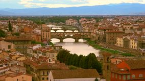 View of the old Golden bridge and the Arno river. Florence, Italy stock footage