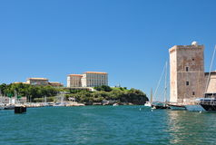 View of the old harbor of Marseille with modern apartment buildings and a square stone tower of Fort Saint-Jean Stock Photography