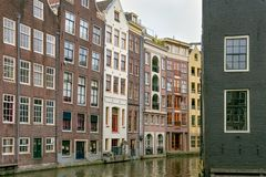 View of the old historical buildings near of the one of the water canals in the center part of Amsterdam. Netherlands stock image