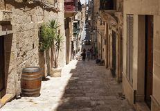 View of old, historical street in Valletta / Malta. Image shows. Architectural style of the city and lifestyle. It`s the capital of the Mediterranean island Stock Photography