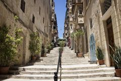 View of old, historical street in Valletta / Malta. Image shows. Architectural style of the city and lifestyle. It`s the capital of the Mediterranean island Royalty Free Stock Images