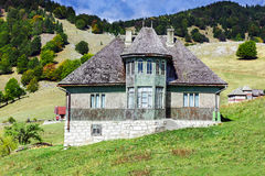 View of an old house. On mountains background Royalty Free Stock Images