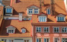 View of old houses walls with windows and roofs. Royalty Free Stock Photo