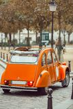 Old retro car in Paris. View of an old iconic retro car in Montmartre in Paris royalty free stock image