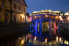 View of the old Japanese bridge in night illumination. Historical landmark of the city Hoi An, Vietnam Royalty Free Stock Photo