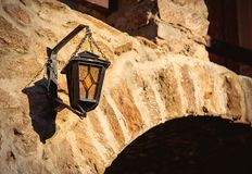 View on old lamp on castle brick wall. Closeup view royalty free stock photography