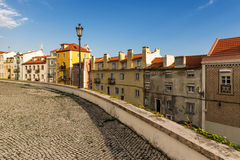 View of old Lisbon. Street in Alfama, Lisbon, with old cobblestone and tiles Stock Images