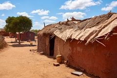 View of an old masai village with huts of clay. Poverty and misery in Kenya royalty free stock images