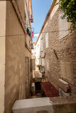 View of old narrow street at city of Budva, Montenegro Stock Image