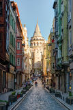 View of old narrow street with the Galata Tower, Istanbul. View of old narrow street with the Galata Tower on may 26, 2013 in Istanbul, Turkey. The Galata Tower stock image
