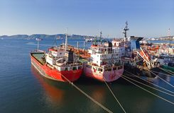 Old oil tanker vessels in a row royalty free stock photos