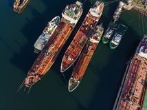 Old oil-tanker vessels & tugs from above royalty free stock image