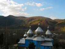 View of the old Orthodox church and the cemetery in the forest royalty free stock photos