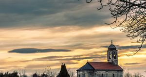 View on the old orthodox church in the city of Pakrac. With sunset in the background Stock Image