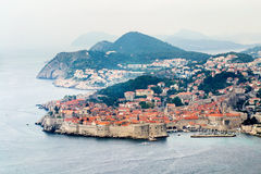 View at old part city of Dubrovnik. Panoramic view at the old, fortified part of the Dubrovnik city in the fog Stock Image