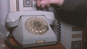 Close-up view on old telephone dial. The view on old phone dial. Old dusty telephone. dirty and dusty phone stock footage