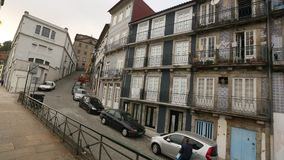 View of the Old Porto from window Heritage tram. PORTO, PORTUGAL - MAY 13, 2015: View of the Old Porto from window Heritage tram. Through the Old city on the stock video footage