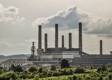 View of old power plant with big concrete furnaces . Fallen chemical communist industry royalty free stock photos