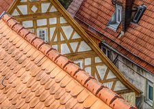 Truss façade and tiled roofs. View in an old residential district, cozy living in well-kept old houses, very old houses after successful retauration stock photos