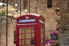 View of old, retro style street telephone box. In Valletta / Malta Royalty Free Stock Photography