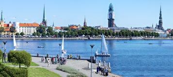View on old Riga city from embankment of the Daugava river, Latvia. Stock Photos