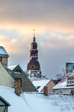 View on Old Riga roofs and Saint Peters Church tower on sunset. Royalty Free Stock Photo
