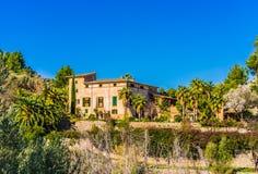 Mediterranean Mansion Villa with palm tree garden stock photography