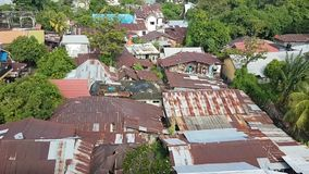 Roofs of city Manado. View on old rusty iron roofs of houses in city Manado, North Sulawesi, Indonesia stock footage