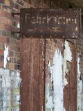 Rusted sign on brick wall. View of an old and rusty sign of a former ticket counter on a brick wall of the Berlin city train from pre-war times Stock Photos