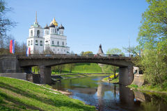 View on the old Sovetsky Bridge and old Trinity Cathedral in the sunny May afternoon. Pskov Russia Stock Images
