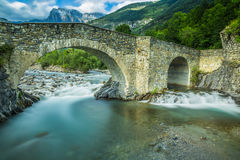 View of old stone bridge over river Royalty Free Stock Photos